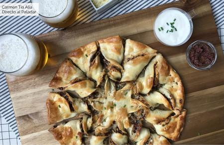 Estrella de pizza rellena de tapenade, champiñón y queso