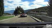 Un Audi R8 Plus dando la vuelta con un 918 Spyder y F12berlinetta