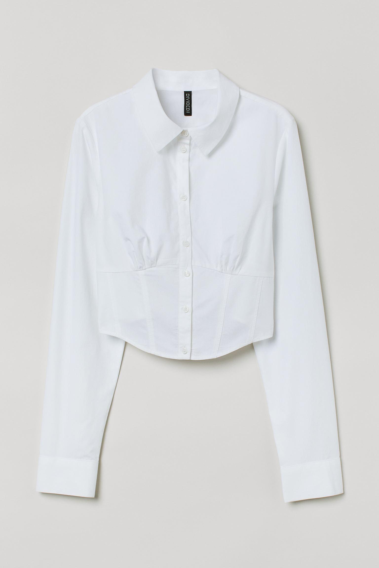 Camisa blanca con diseño encorsetado