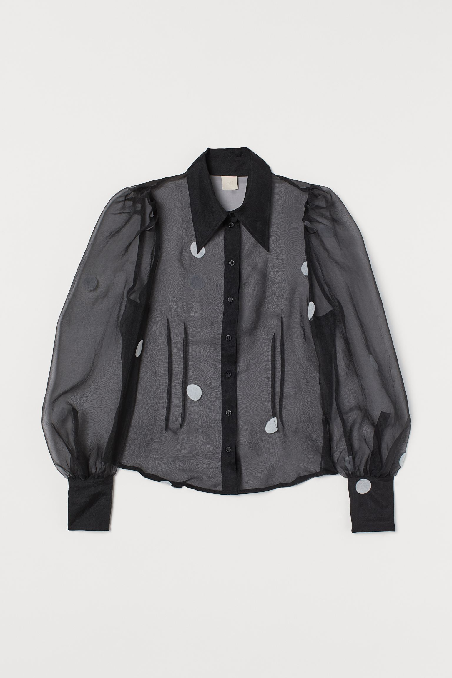 Blusa transparente con mangas puffy