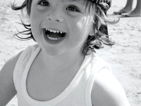 Los beneficios de la sonrisa de tu hijo
