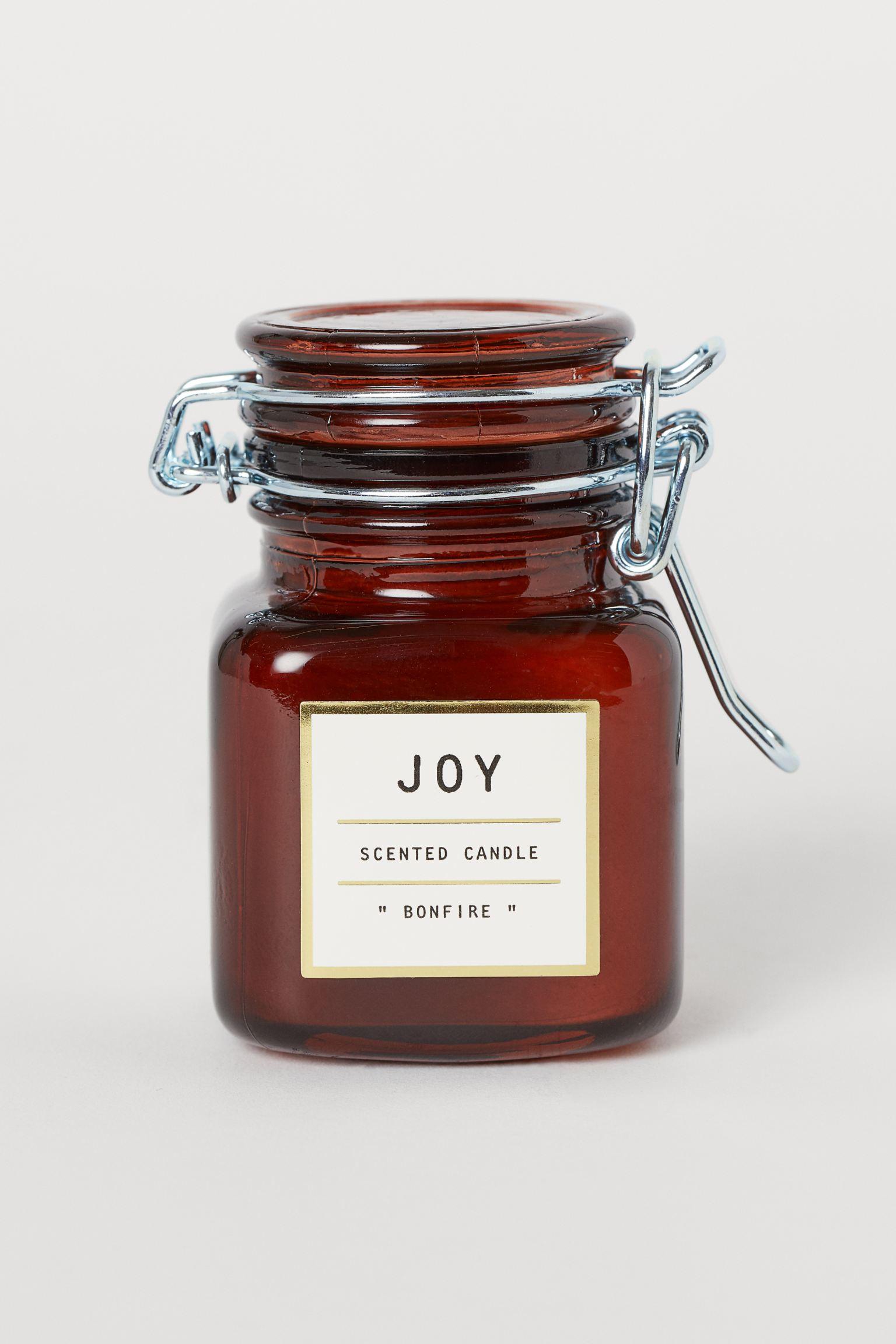 Vela con aroma a hoguera en frasco