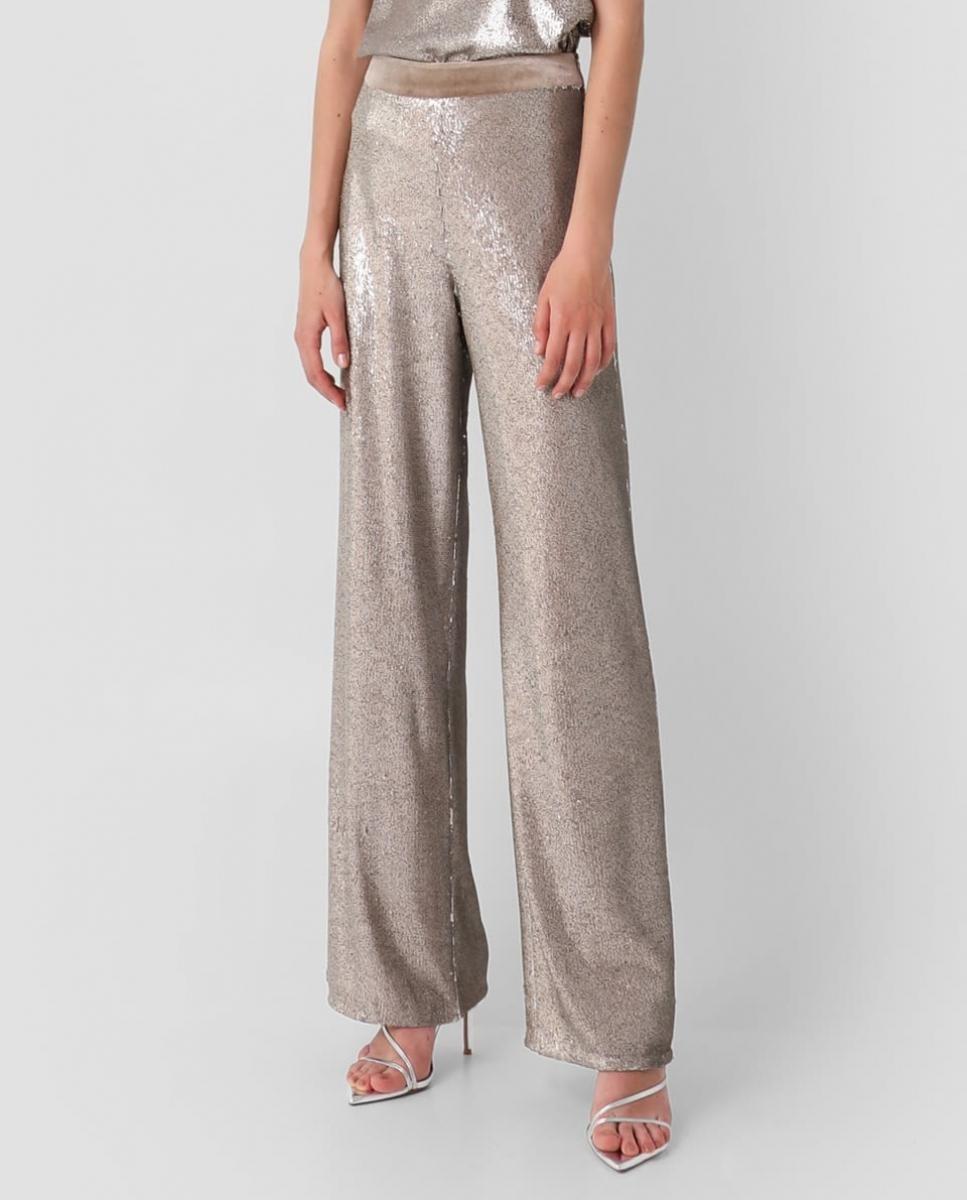 Pantalón ancho oversize de tejido glitter plateado.