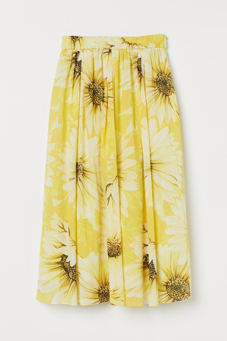 Falda midi con estampado de girasoles