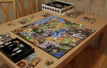 1024px Small World Game Being Played
