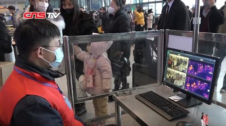 Staff Monitoring Passengers Body Temperature In Wuhan Railway Station During The Wuhan Coronavirus Outbreak