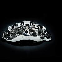 Bugatti Chiron: 2.213 capas de titanio y cuatro láser para imprimir una pinza de freno en 3D