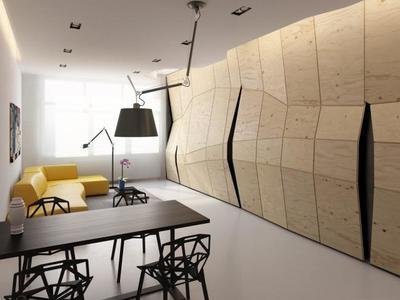 Un muro polifacético para organizar un apartamento de 60 metros cuadrados