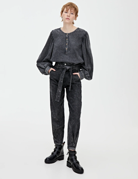 Jeans slouchy negros cinturón