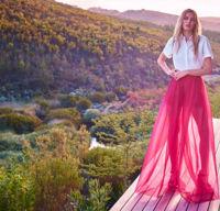 Delpozo diseña su primera colección cápsula para Net-à-porter con mucho tul al viento y colores pop