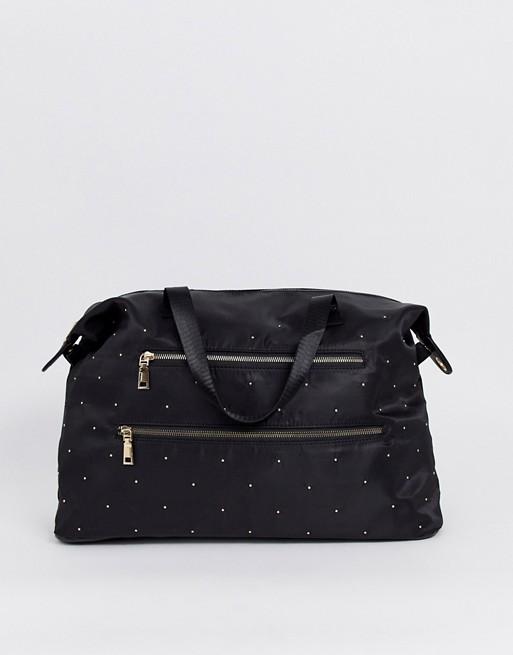 Bolso de viaje en negro de Yoki Fashion.