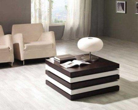 Una mesa de centro con compartimentos ocultos