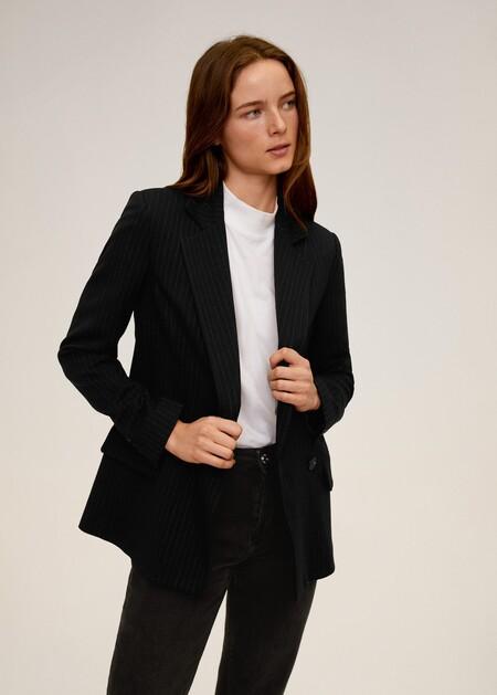 https://shop.mango.com/es/mujer/abrigos-trench/trench-clasico-cinturon_77055129.html