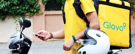 Glovo delivery man with mobile in hand