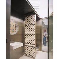 Una pared muy original para separar el baño