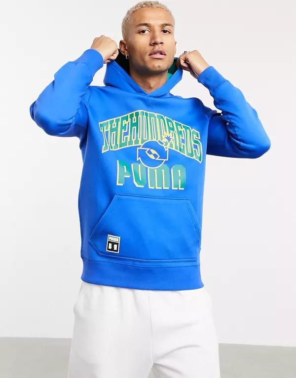 Sudadera azul y verde de diseño reversible con capucha y logo universitario en grande de Puma x The Hundreds