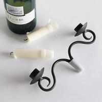 Velas en las botellas de vino
