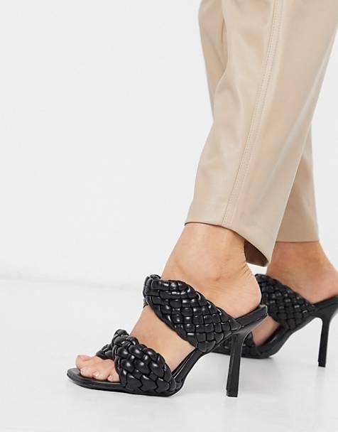 Sandalias negras trenzadas con tacón alto