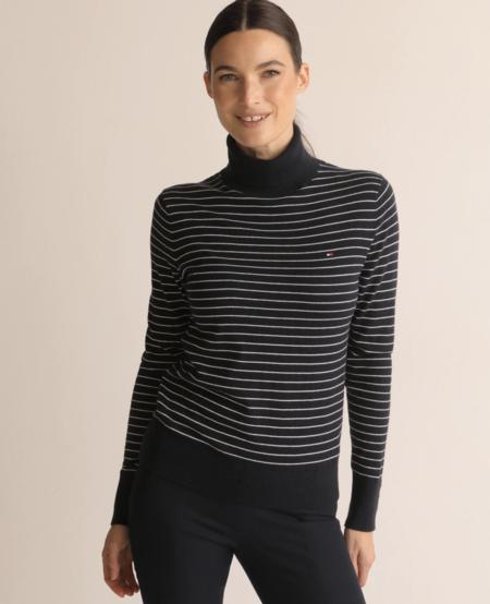 Jersey de mujer 100 % algodón cuello alto y manga larga.