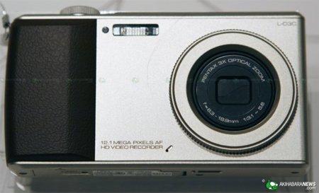 LG L-03C: teléfono móvil dentro de una cámara compacta, a contracorriente