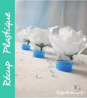 flor en botella de plástico