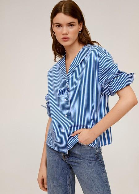 https://shop.mango.com/es/mujer/camisas-camisas/camisa-fluida_67083254.html?c=08