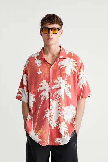 Camisa manga corta con estampado de palmeras