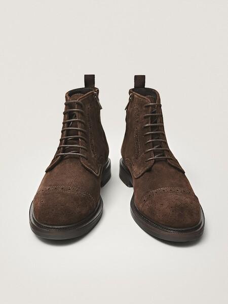 Las Botas Con Detalle Troquelado Seran El Calzado Estrella Que Realzara Todos Tus Looks De Otono