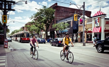 Cyclists On Queen