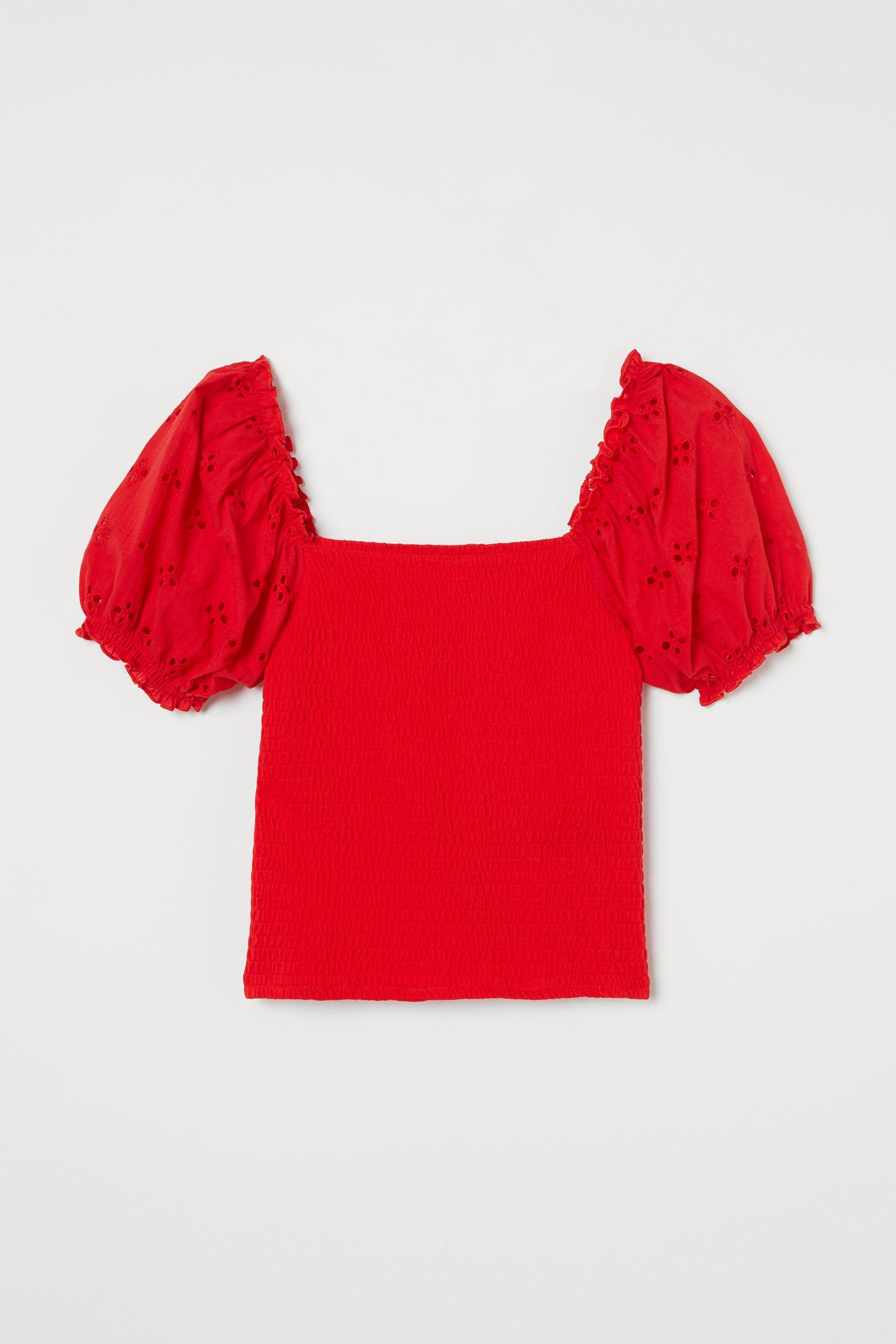 Blusa con mangas abullonadas y bordados